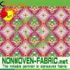 Nonwoven printed packaging fabric