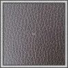 PVC brownish red litchi texture leather