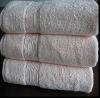 Solid bath towel with border
