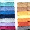Solid towel in plain with dobby border