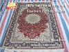 hand knotted persian rug with silk inserts