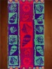 red and purple printed beach towel