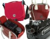 various red leather camera bag
